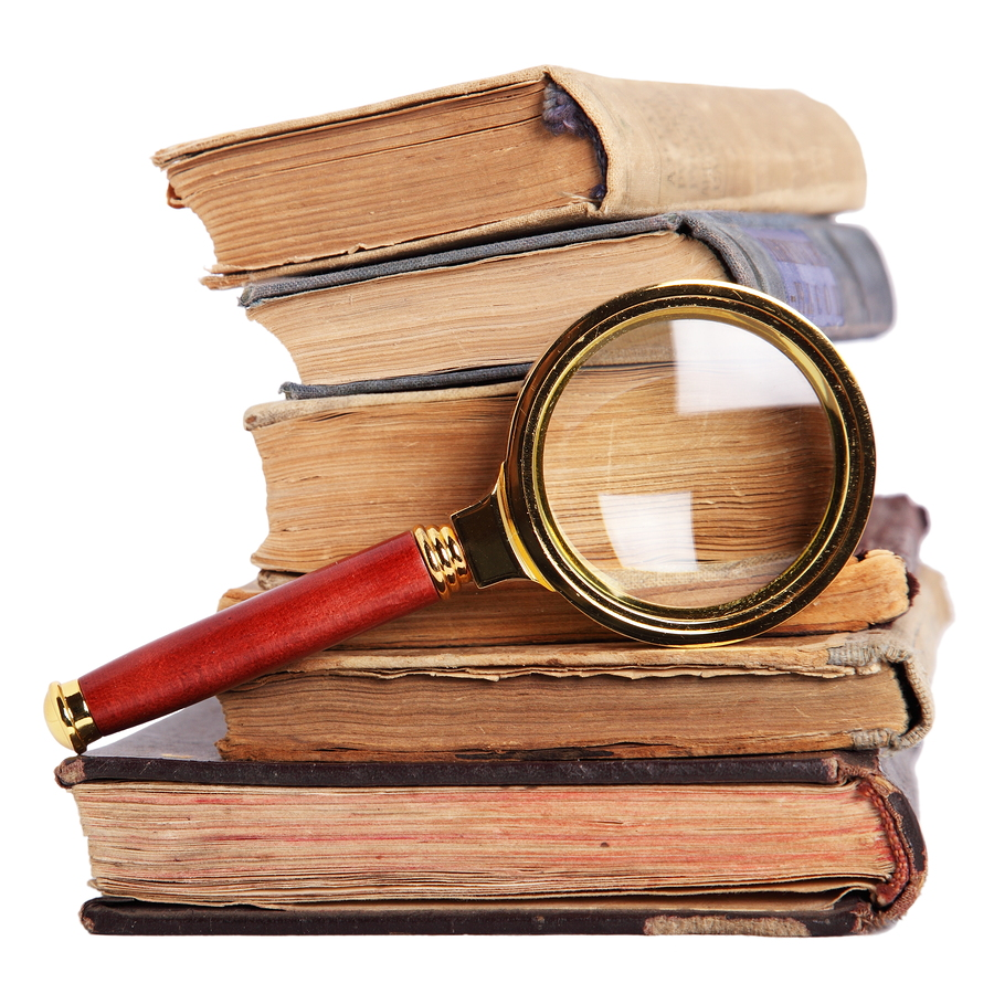 bigstock-Stack-Of-Books-And-Magnifying-6753013.jp_.jpg